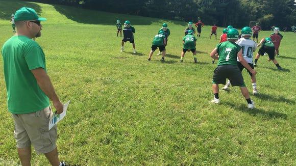 Irvington coach Steve Yurek looks on as the football