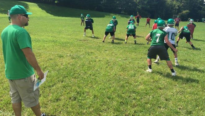Irvington coach Steve Yurek looks on as the football team practices at Dows Lane Elementary School in Irvington on Aug. 16, 2016.