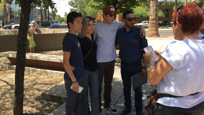 Marco Tulio Coss Ponce and his family gather for a picture after he walked out of the ICE building on April 12, 2017.