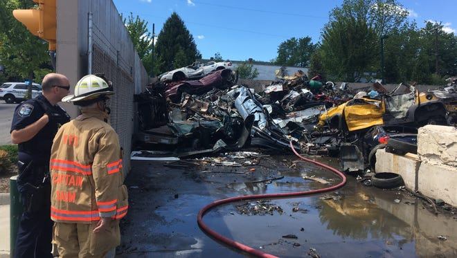 Waynesboro Fire Department Capt. Allen Saum looks out over the pile of debris that caught fire Monday morning at Recycle Management in Waynesboro, Va.