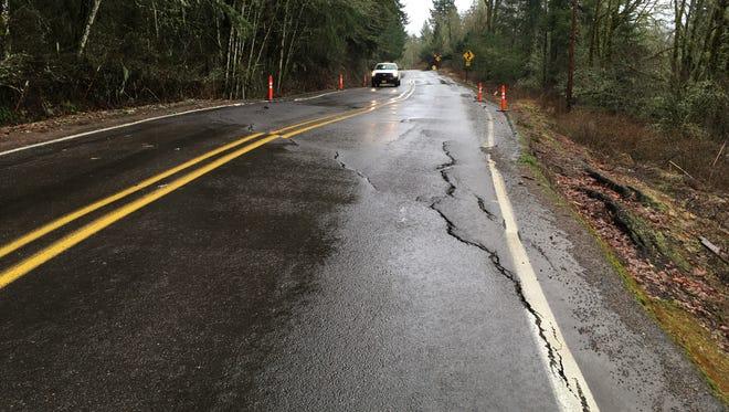 Landslide damage to River Road South.