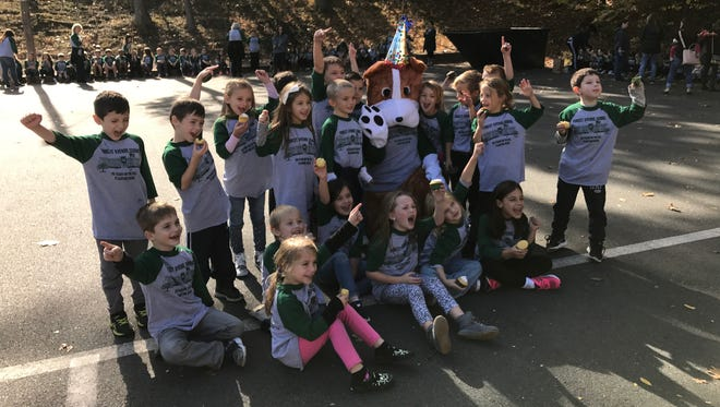 Forest Avenue School's costumed mascot, representing the Bulldog mascot, is introduced during the Verona school's 90th anniversary on Oct. 27, 2017.