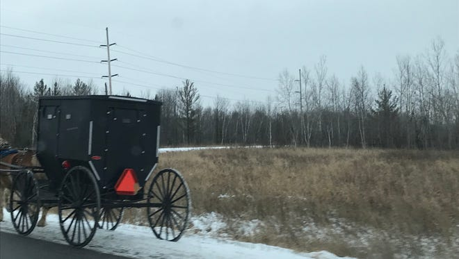 A new reflective triangle, reflective tape and red lights on a buggy in Wood County Friday morning shows signs that efforts to improve safety are having some effect.