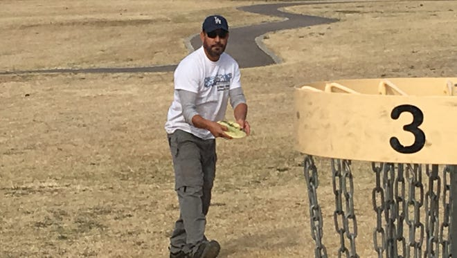 Disc golfer Victor Villalobos lines up for a shot at the basket Saturday at Lionel Forti Park. The group is hosting the 4th annual Ice Bowl Tournament.