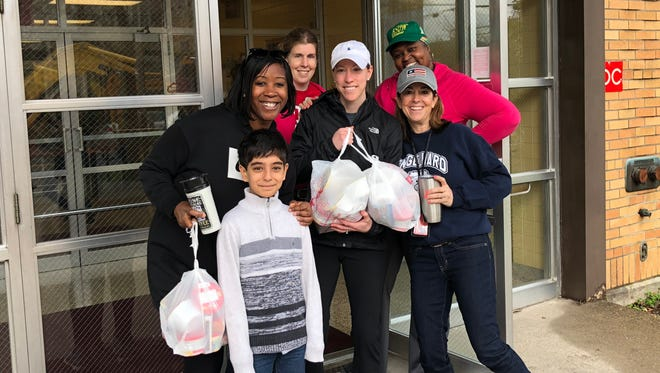 After JCPS canceled school Friday, Engelhard Elementary School staff volunteered to organize and deliver Blessings in a Backpack food to their students. March 30, 2018