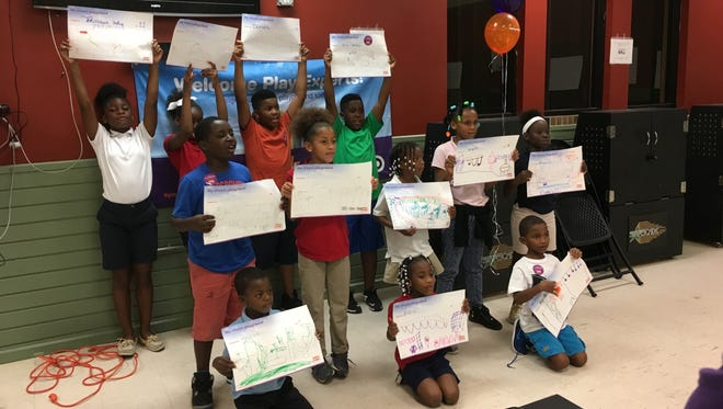 Children at the Stars Complex in Fort Myers show off their dream playground designs.