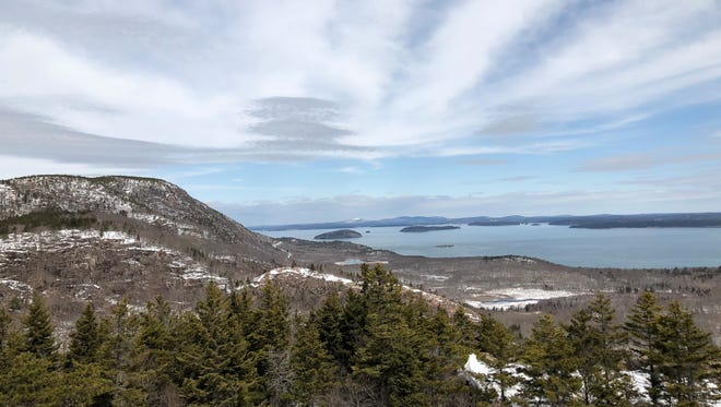 A sweeping view from the summit at Acadia National Park in Maine gives pause to reflect.