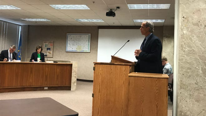 County Auditor Bob Litz speaks to the Minnehaha County Commission Monday morning.