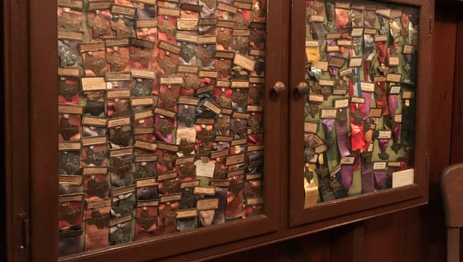 Past Texas Cowboy Reunion Old Timers membership badges are displayed at the Bunkhouse in Stamford.