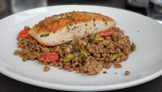 Pan-seared salmon with farro ($26) from Empire Kitchen & Cocktails in Detroit's Brush Park neighborhood.