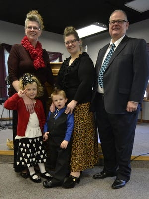 Flanked by parents Teresa and the Rev. Peter Fraser are Autumn Placek and her two children, from left, Analeigh, 4, and Ryan, 3. Placek's husband Michael died in early December of a brain injury. Peter Fraser is the senior pastor at Lighthouse Apostolic Truth Church in Ashwaubenon.