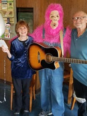 A pink gorilla showed up at the 35th wedding anniversary party of Diane and Steve Homfeldt on Monday at Valent's bar in Milwaukee. The gorilla revealed the surprise news to Diane that she and Steve would be dropping the first puck at a Milwaukee Admirals game Tuesday, an honor that Steve had hoped to do on their wedding day in 1983.