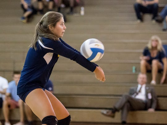 Port Huron Northern sophomore Madison Adair digs the ball during a volleyball game Thursday, September 15, 2016 at Port Huron Northern High School.