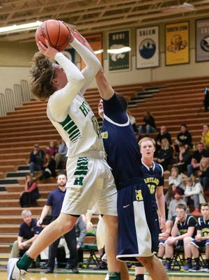 Johnny Shields (13) is fouled in Howell's 52-34 victory over Hartland Tuesday night in Howell. Shields finished the contest with a game high 16 points on the evening.