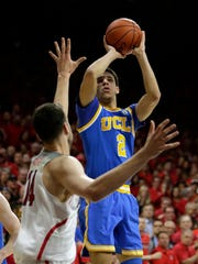 UCLA guard Lonzo Ball shoots over Arizona center Dusan