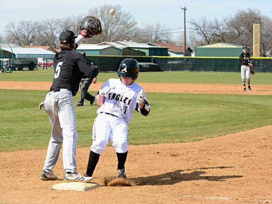 Abilene High's Andrew Ezzell gets back to first base