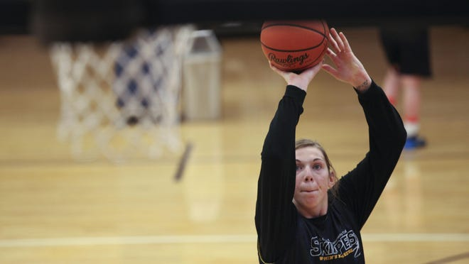 Lady Skipper's Rachel Kehoe takes a shot as she runs drills during practice in December 2013 at the SC4 gymnasium.