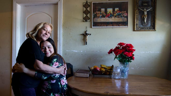 Jennyfer Gerrero Torres hugs her mother, Maria Torres, at their home in Immokalee recently. Jennyfer is the first student from Immokalee High School to gain acceptance to Harvard University as an undergraduate.