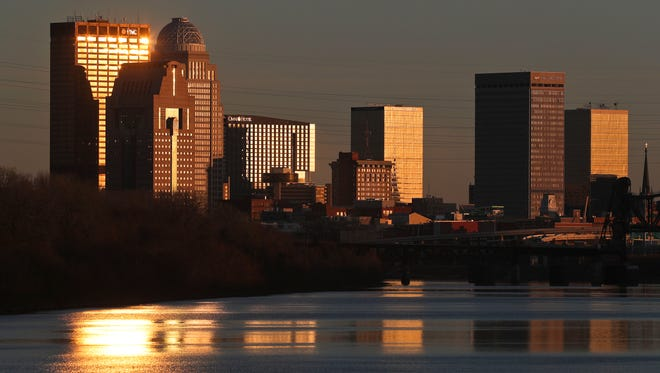 Louisville's skyline glows above the Ohio River in the setting sun recently. The widest point of the Ohio is one mile across, just north of Louisville. The river's height fluctuates throughout the year, depending on rainfall in the area and from areas to the northeast.