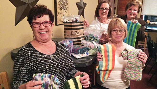 (From left) Dolly Marciano, Fran Andolaro, Josie Neil and Betsy Perugini, members of the Zonta Club of Cumberland County, are pictured with some of the items they prepared to send to India as part of an international service project.