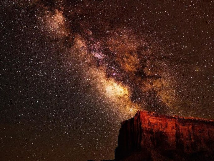 Milky Way rises over Monument Valley.