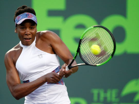 Venus Williams returns a shot from Danielle Collins during a tennis match at the Miami Open, Wednesday, March 28, 2018, in Key Biscayne, Fla. (AP Photo/Wilfredo Lee)