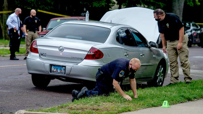 Police officers search near the intersection of North Atlantic Avenue and East Frye Avenue in Peoria following a shooting in this 2020 file photo. As they work major shootings and homicide cases, officers frequently incur overtime, part of a multimillion-dollar cost each year to the city.