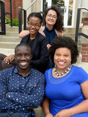 Earlham College students Wyclife Omondi, Leslie Ossete, Sonia Kabra and Iman Cooper are Team Magic Bus, one of six remaining teams out of 25,000 entrants for the $1 million Hult Prize.