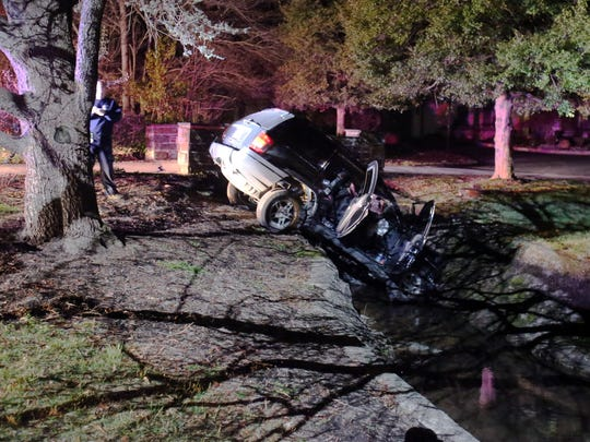 A SUV rests in a creek at the end of a cul-de-sac on Talley Road in Brandywine Hundred after a police chase that started in Pennsylvania before 9 p.m. Thursday.