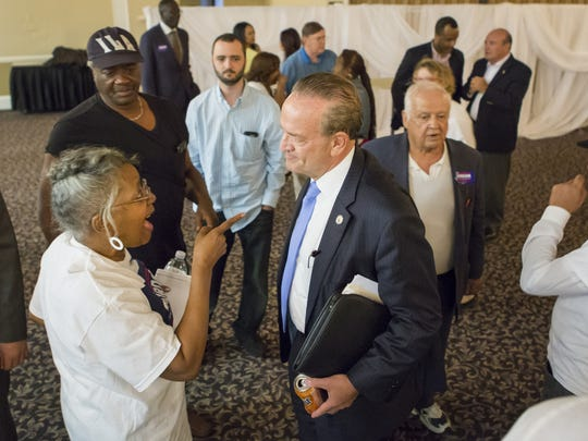 New Castle County Executive Thomas P. Gordon talks with guests following a debate in Hockessin on Aug. 2. He was defeated in the Democratic primary Tuesday by Matt Meyer.