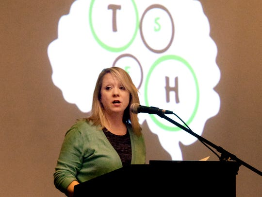 """Kathy Minnich, a Northeastern School District social worker, speaks during the York County Youth Mental Health Alliance at Wyndham Garden York Monday, Feb. 6, 2017.  Behind her are the letters representing the alliance's motto, letting people know, """"The Silence Ends Here.""""  Students from York County districts questioned a panel of county leaders during the town hall-style meeting. Bill Kalina photo"""