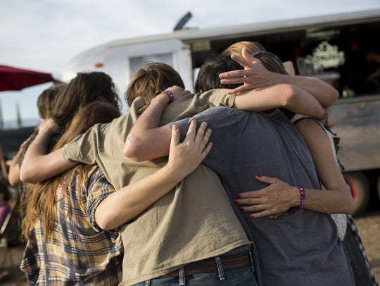Festivalgoers gather in a group hug at the FORM Arcosanti festival on May 12, 2017.