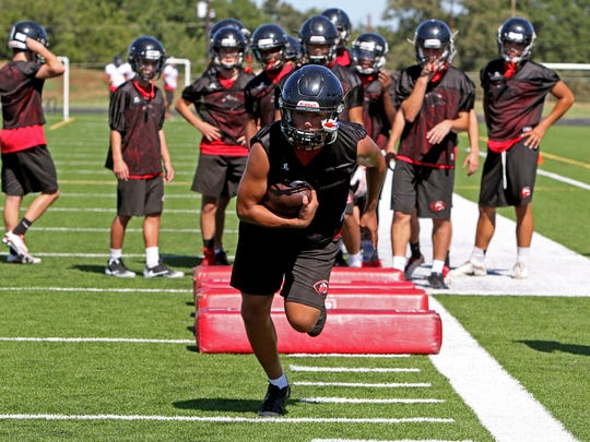 Wichita Falls High School football players run through drills Monday, Aug. 14, 2017, for the second week of two-a-day practices on the Old High practice field.