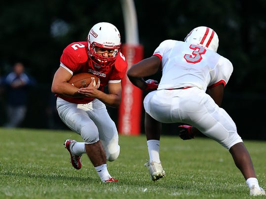 Dunellen #2 Mike Harmon about to get hit by Bound Brook