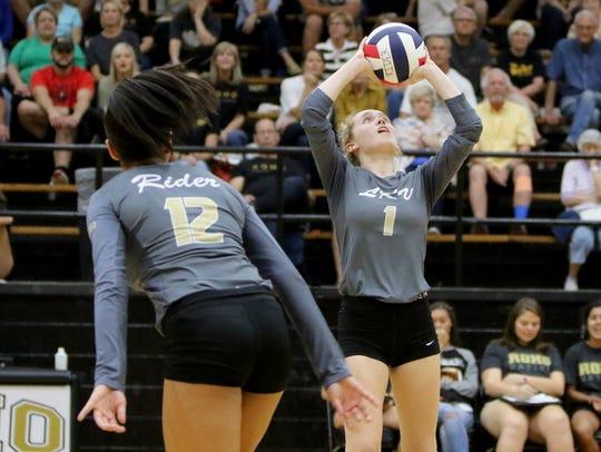 Rider's Lauren Dodson sets the ball against Denton