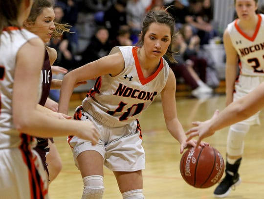 Nocona's Emma Meekins dribbles in the game against