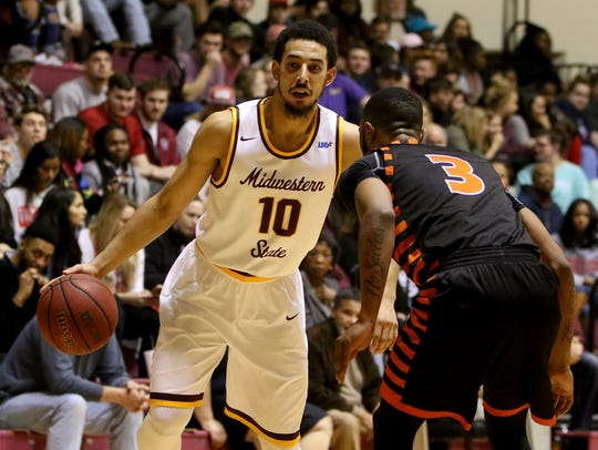 Midwestern State's Trey Kennedy dribbles while guarded by UT-Permian Basin's James McPherson Thursday, Feb. 8, 2018, at D.L. Ligon Coliseum. Kennedy went 4 of 6 from 3-point range for the second straight game. He's scored 19 points in each of those games bringing his average to 9.0 per game.
