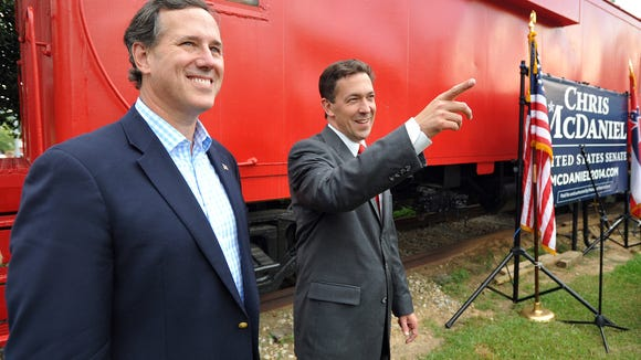 Former Sen. Rick Santorum, left, and Senate candidate Chris McDaniel, greet supporters.