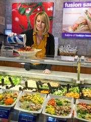 Colleen Mading prepares a meal at her Saladworks franchise