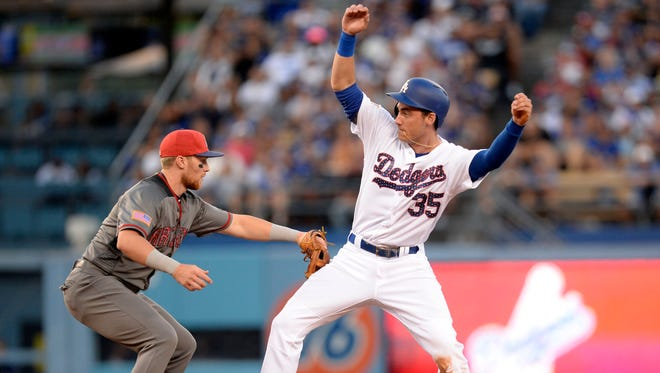 July 4, 2017: Los Angeles Dodgers left fielder Cody Bellinger (35) reaches second against Arizona Diamondbacks second baseman Brandon Drury (27) as he misses the throw in the fifth inning at Dodger Stadium.