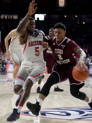 Texas Southern guard Zach Lofton (2) drives on Arizona guard Kadeem Allen during the first half of an NCAA college basketball game, Wednesday, Nov. 30, 2016, in Tucson, Ariz.