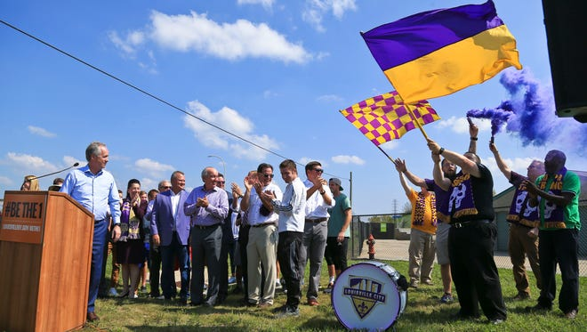 Louisville City fans celebrate after Mayor Greg Fischer announced Sept. 22 the city will be using $30 million to help investors build a 10,000-seat soccer stadium in the Butchertown area. Louisville City FC will repay $14.5 million over 20 years from sales of land and stadium rent.