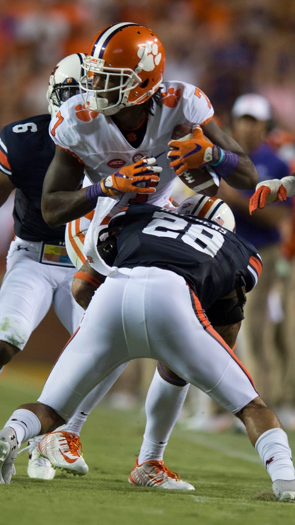 Auburn defensive back Tray Matthews (28) stands up
