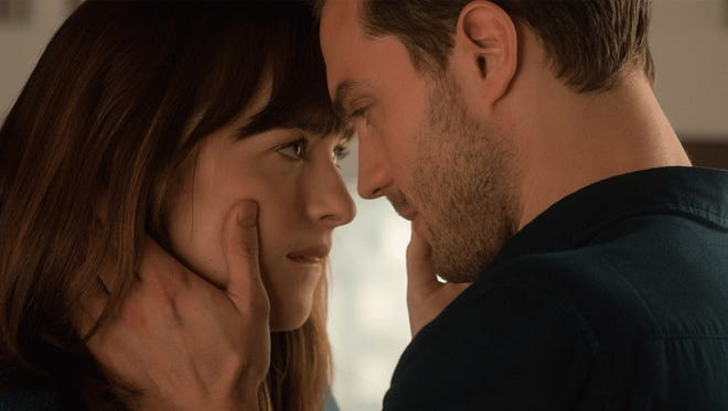 """Dakota Johnson and Jamie Dornan in the film """"Fifty Shades Darker."""" The movie is playing at Regal West Manchester Stadium 13, Frank Theatres Queensgate Stadium 13 and R/C Hanover Movies."""