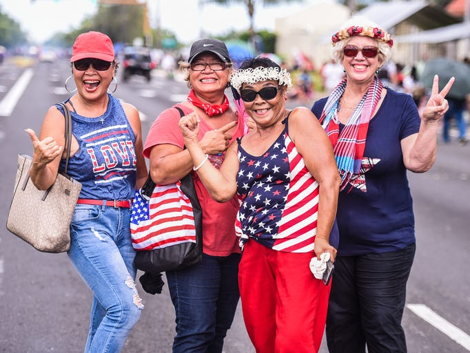 Dressed in patriotic colors, a group of parade-goers