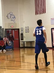 "A Kings recreational basketball league player wears a ""Knee Grow"" jersey in a game against a Milford team in 2017 at Kings Junior High."