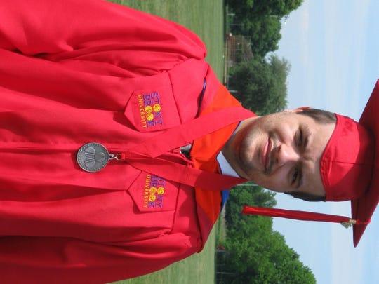 Despite his illness, Jonathan Schmidt proudly graduated