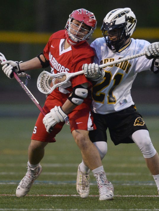 Susquehannock's Noah O'Brien, left, tried to work around Red Lion's Cole Snyder during a boys' lacrosse game on April 23. The Warriors finished the regular season with a 13-2 overall record, and are seeking their first YAIAA tournament championship tonight against West York.