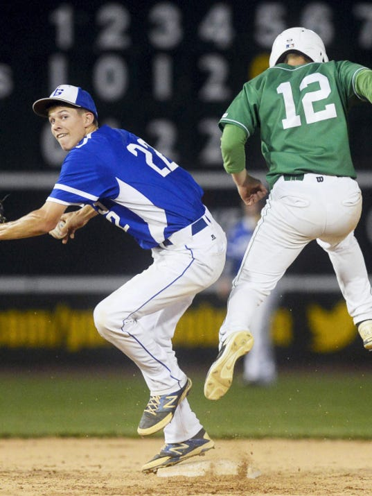 Spring Grove's Brandyn Schuchart forces out Donegal's Tyler Snyder at second before trying to turn a double play during Thursday's PIAA District 3 Class AAA baseball championship game at Santander Stadium in York. Despite losing to Donegal 11-5 in extra innings, the Rockets will take the field in next week's PIAA tournament.