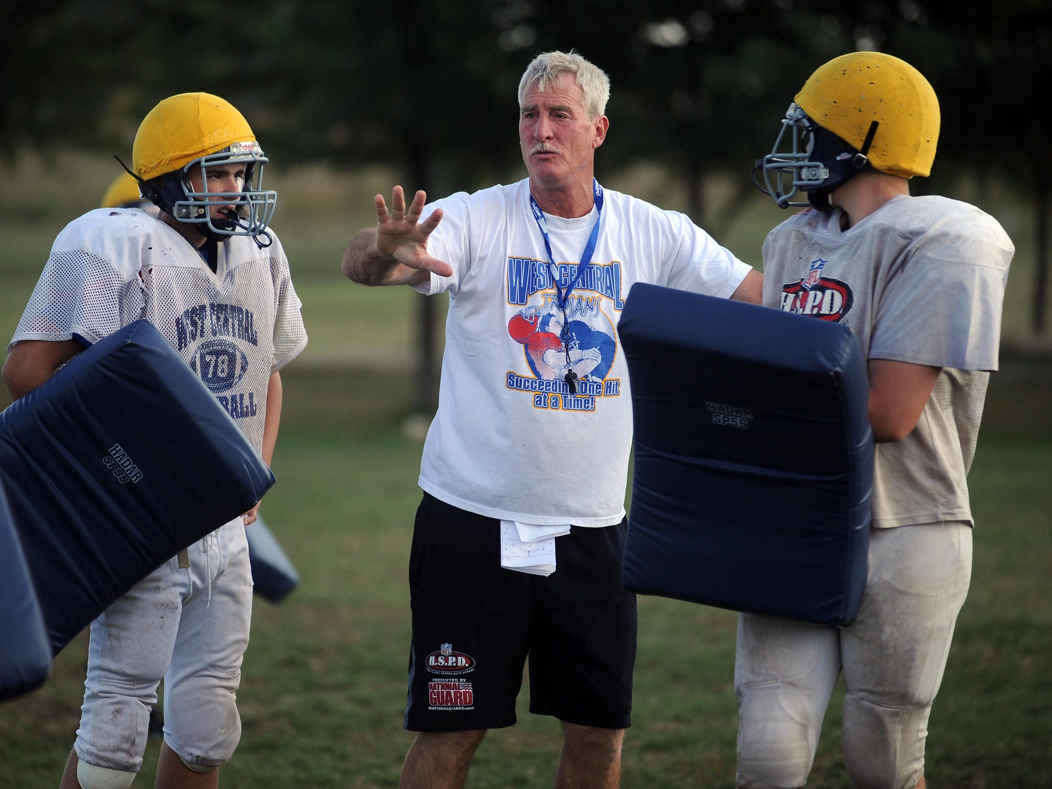 West Central coach Kent Mueller instructs his players during practice in 2013. Mueller's squad is preparing for a Friday night showdown with Canton, which won the 2013 Class 11B championship.